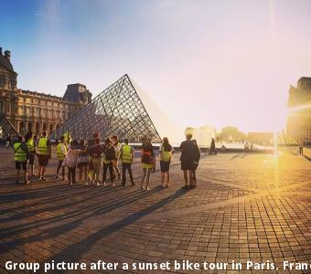 Group picture after a sunset bike tour in Paris, France